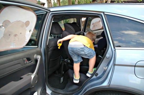 Logan climbing into car 2