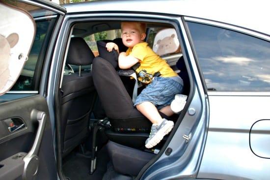 logan climbing into the car 3