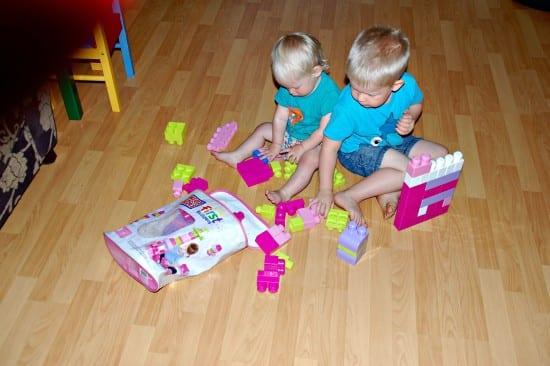 Logan and Aria playing with Pink Mega Bloks 2