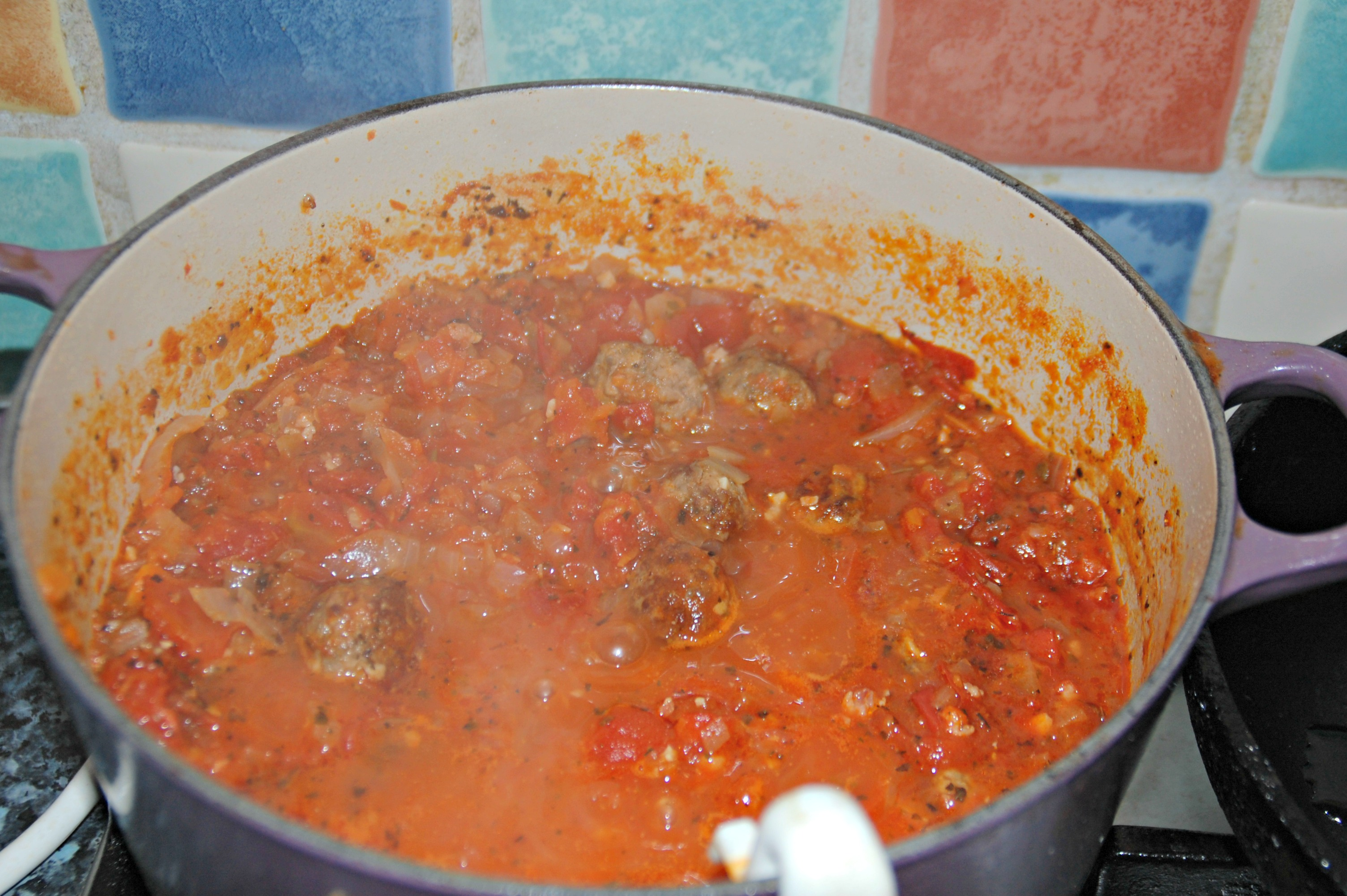 Red ragu and meatballs simmering
