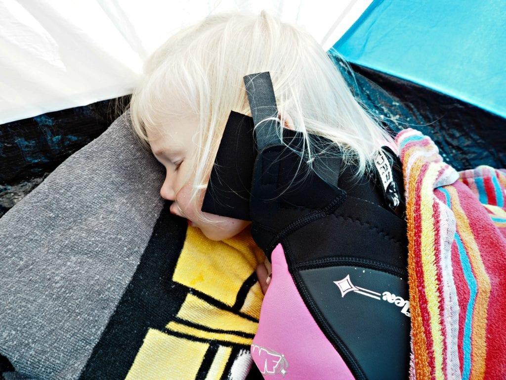 Aria asleep on the beach
