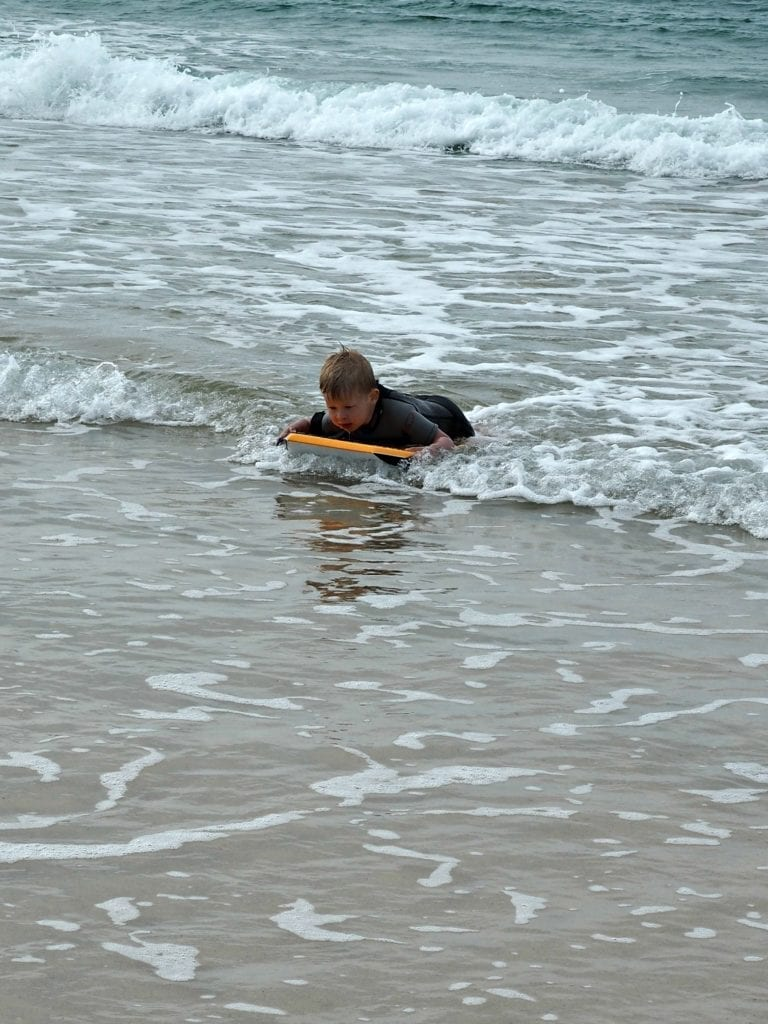 Logan learning to surf
