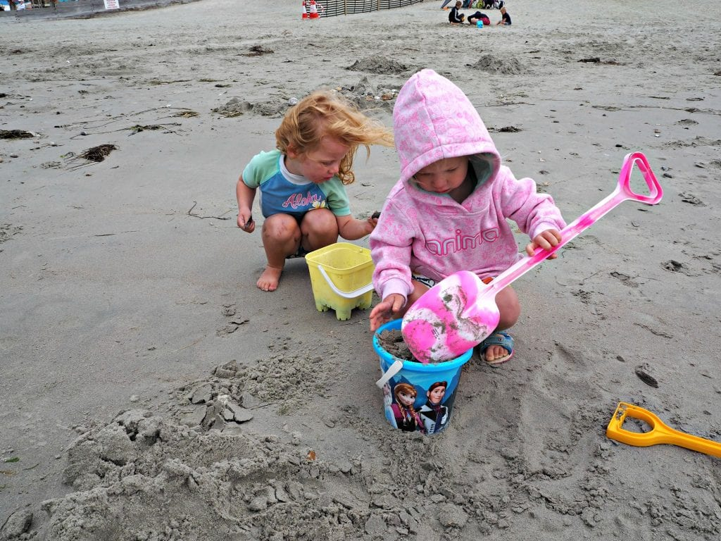 rainy beach building sandcastles