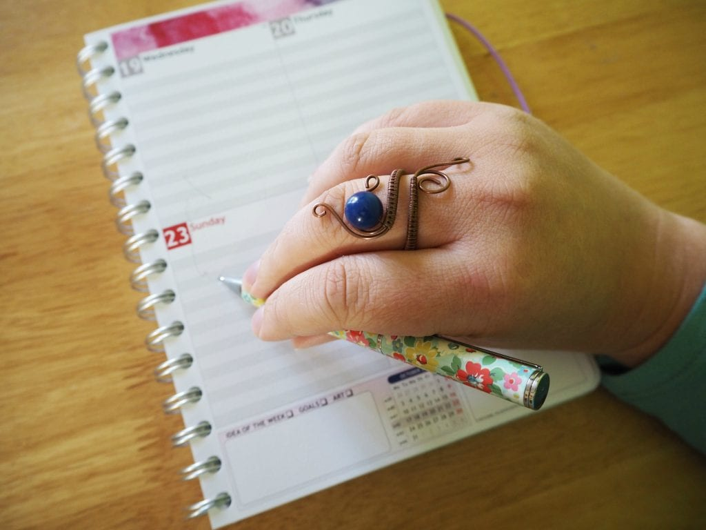 Kerrie-David-jewellery-writing-with-ring