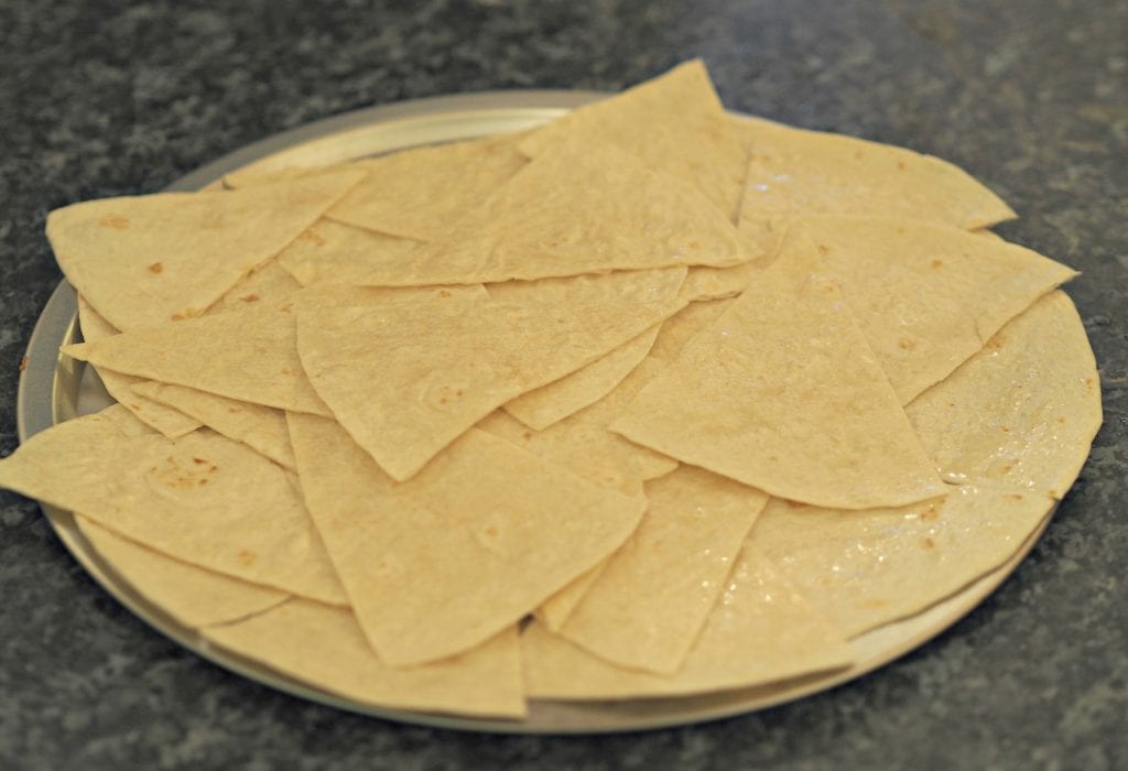 Simple Nachos Recipe - cut into wedges