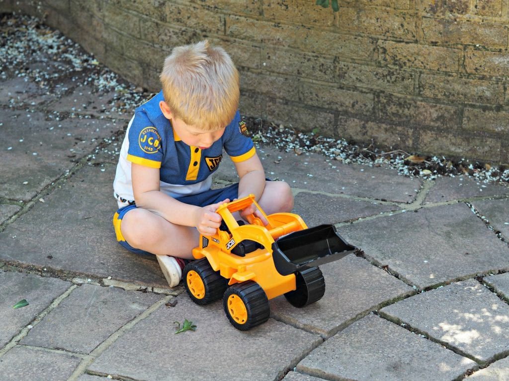 JCB Kids M&Co Shorts and Polo Shirt - Logan playing with digger 2