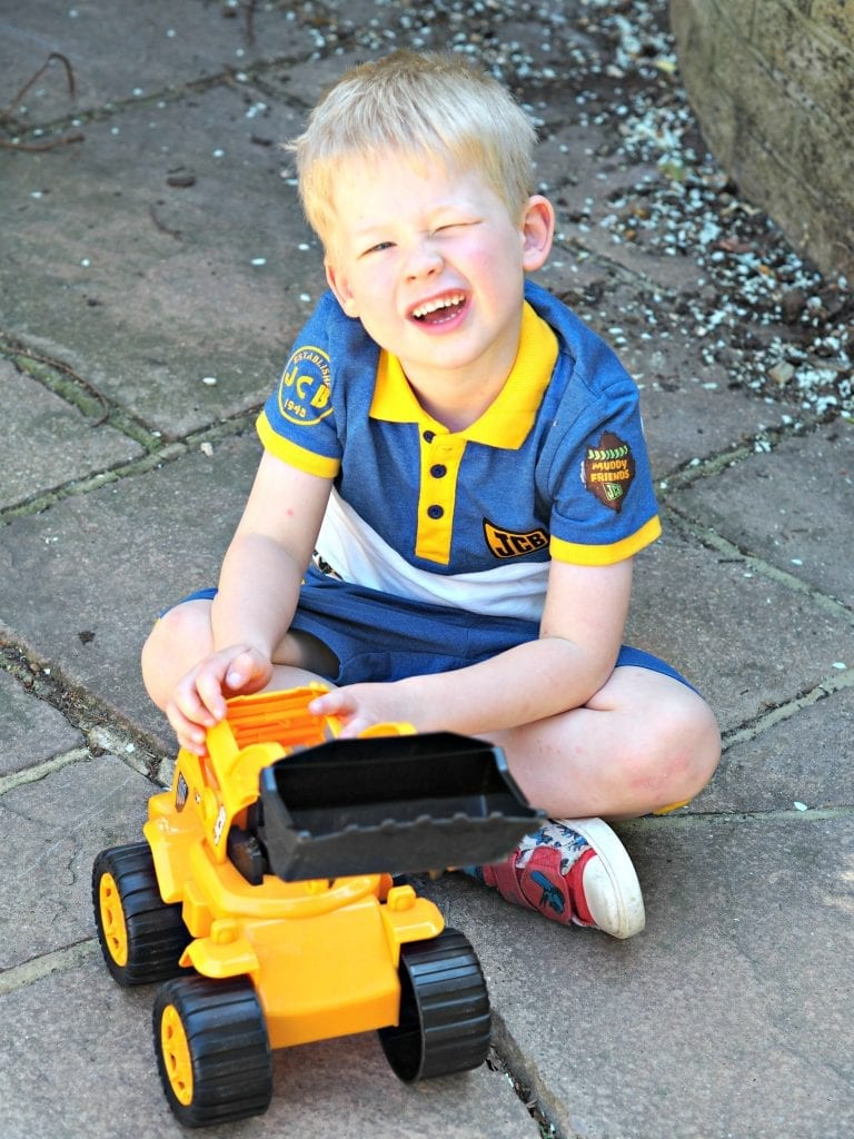JCB Kids M&Co Shorts and Polo Shirt - playing with digger