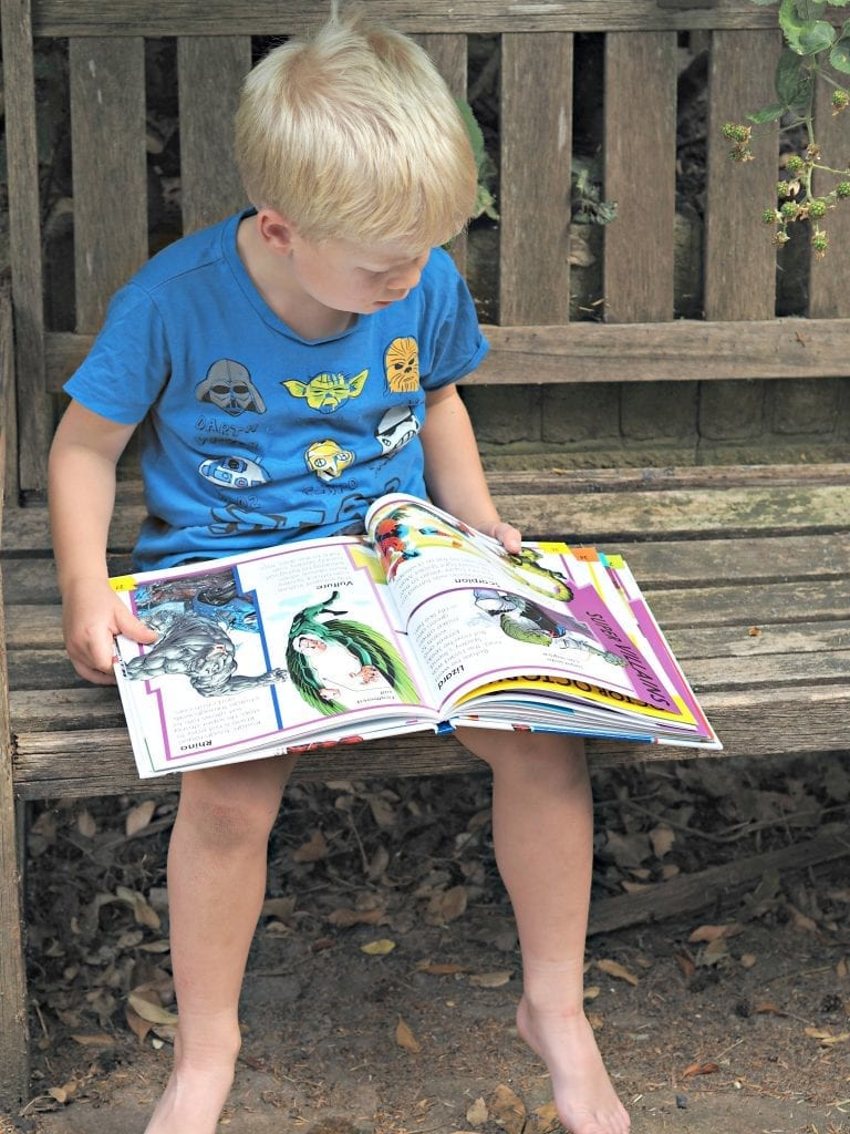 DK Spiderman Books - Logan reading