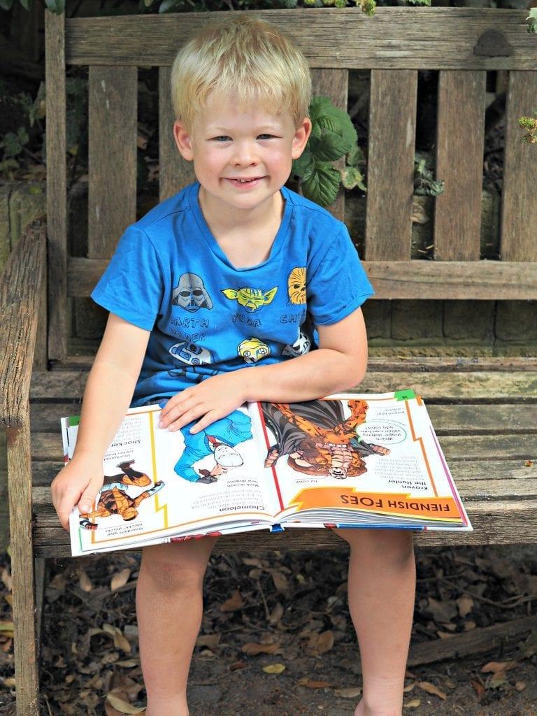 DK Spiderman Books - Logan reading & smiling