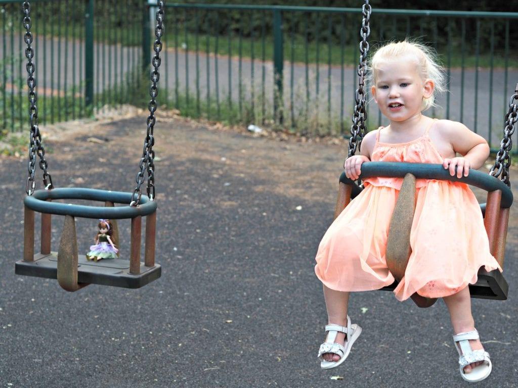 Lottie Doll on the swings