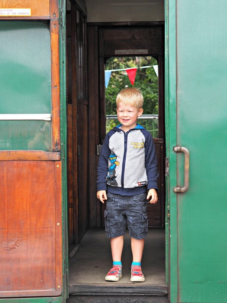 Day out with Thomas at the Watercress Line - Logan on the train