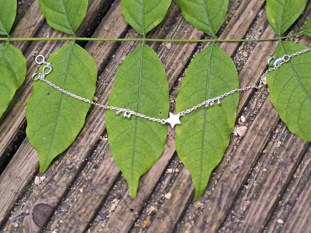 Daisy London Little Star Bracelet Review - bracelet on leaves