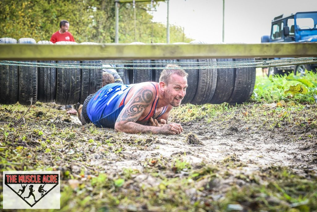 Muscle Acre Mud Slog November 2017 Review - Ben crawling obstacle