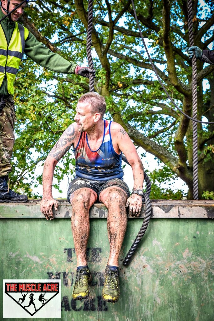 Muscle Acre Mud Slog November 2017 Review - Ben sitting on wall