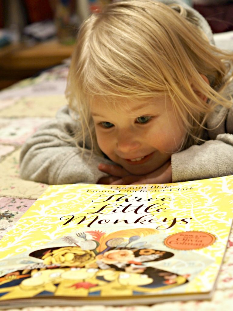Three Little Monkeys by Quentin Blake & Emma Chichester Clark - Aria looking at the book