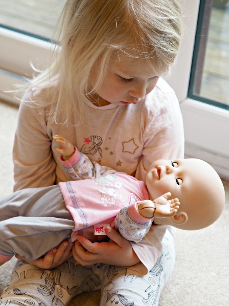 Milestone Myths with Baby Annabell Learns to Walk - Aria cradling doll