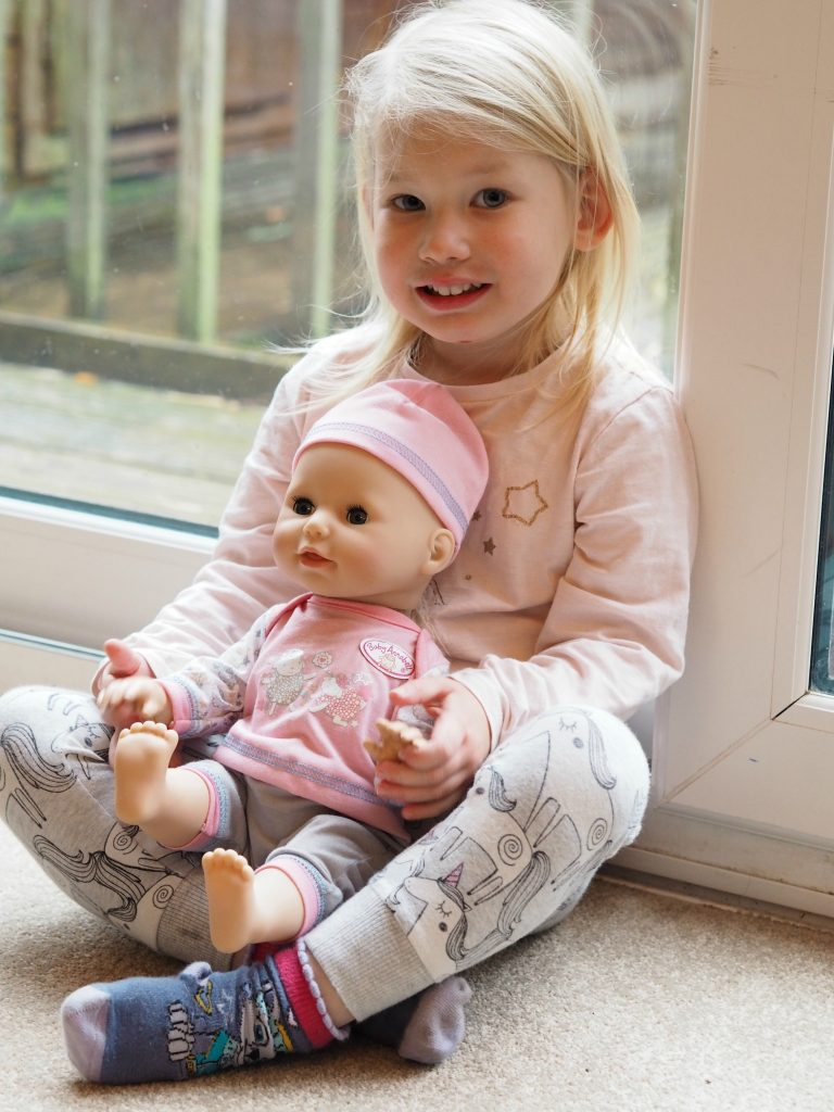 Milestone Myths with Baby Annabell Learns to Walk - Aria sitting with doll