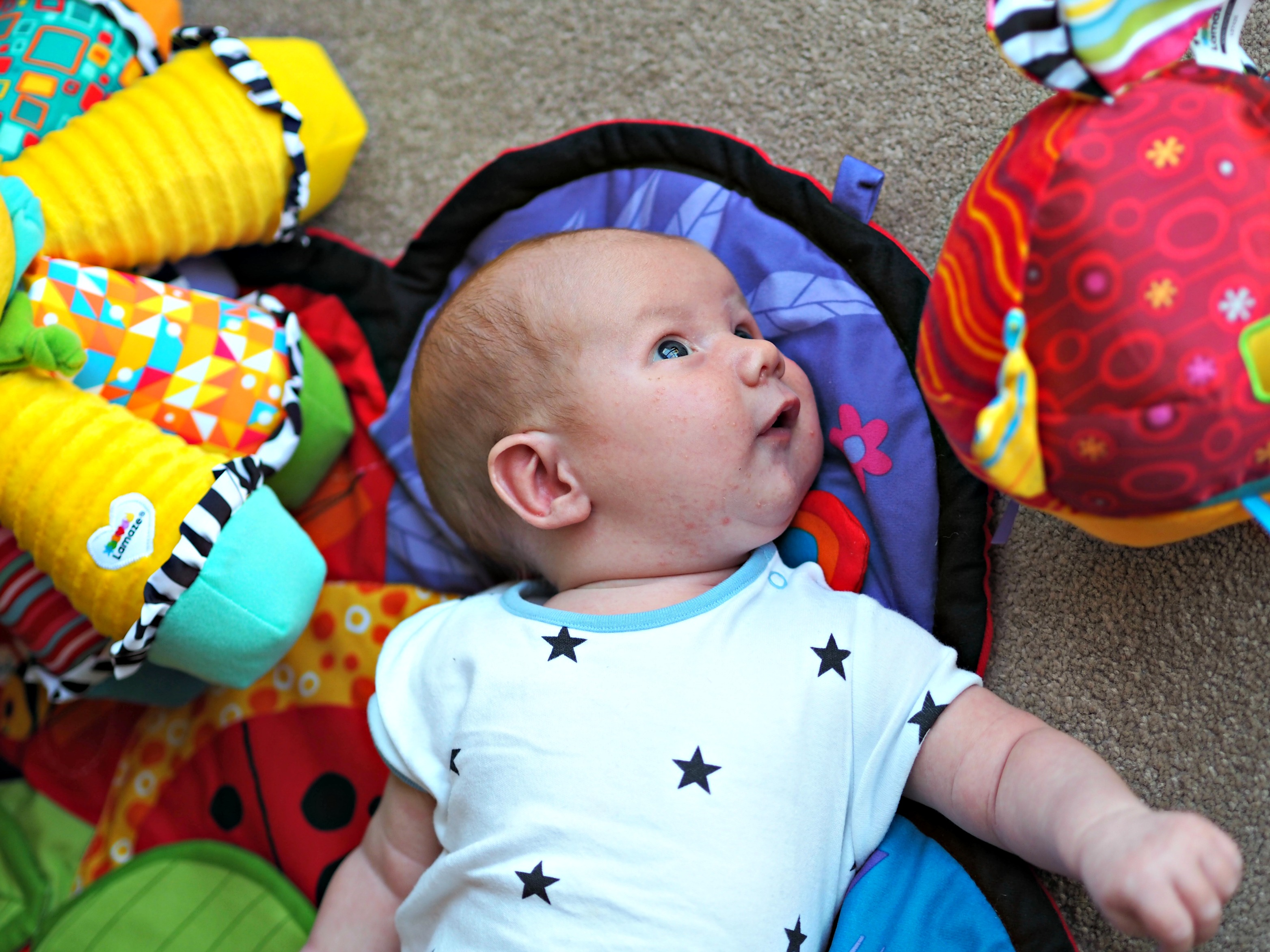 Encouraging Baby's Development with Tomy Lamaze - Bo with new toys
