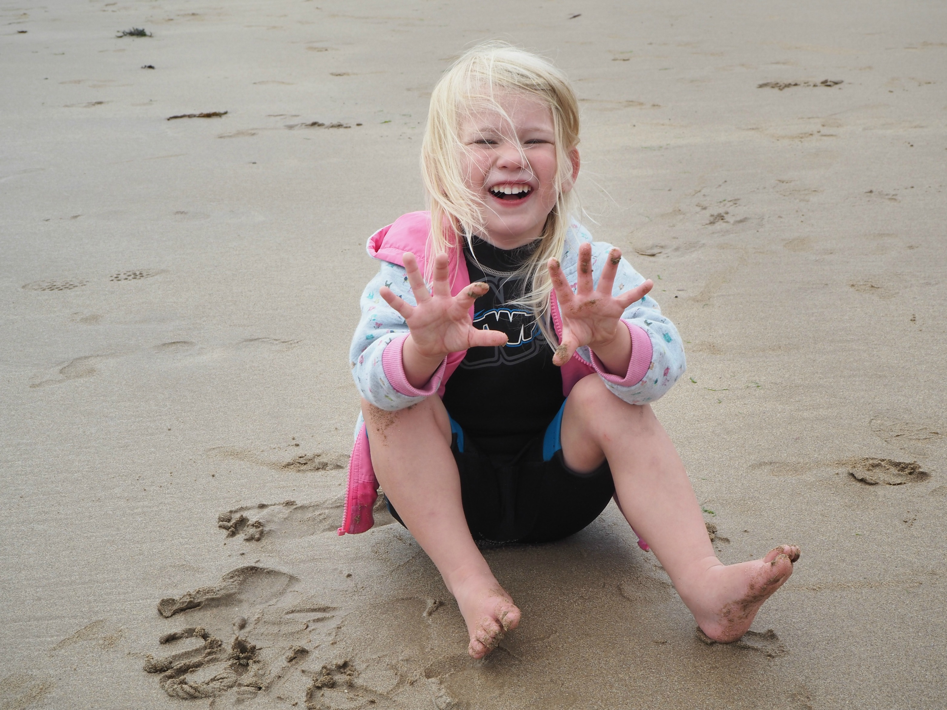 Our Welsh Holiday Highlights - Summer 2018 - Aria sandy hands