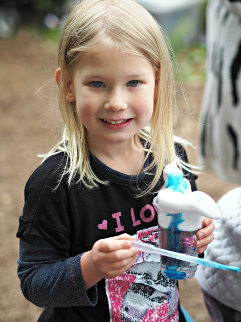 Aria at her muddy boots party holding a storm cloud cup