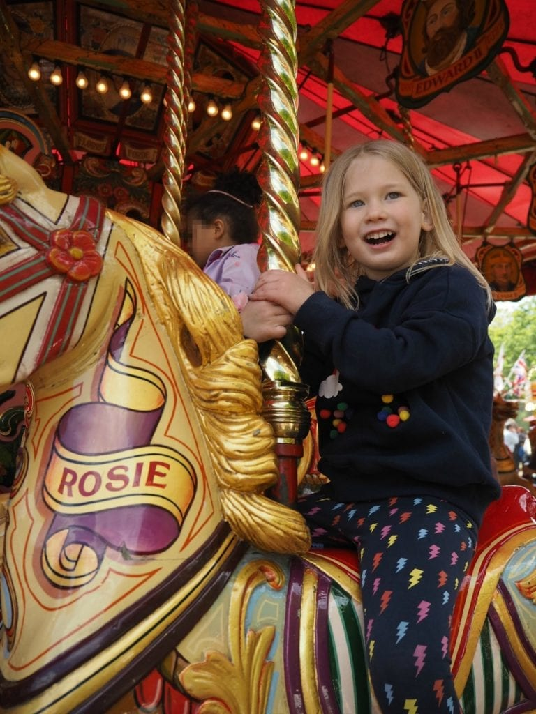 Aria sitting on carousel horse