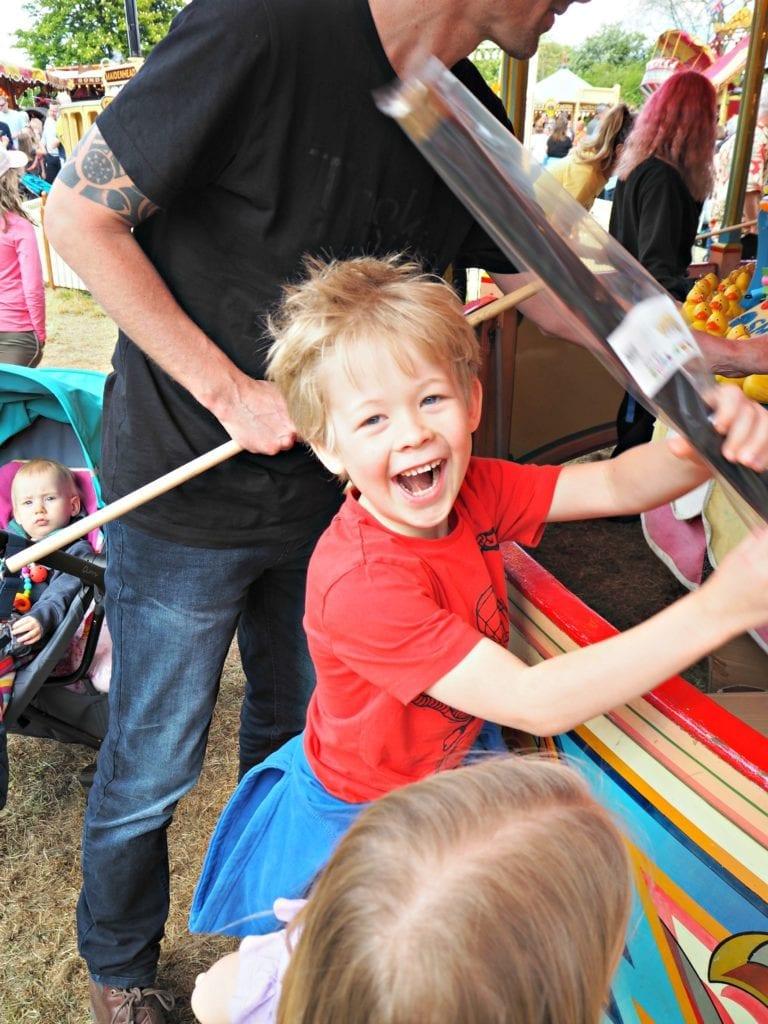 Logan winning at the hook a duck at Carter's Steam Fair