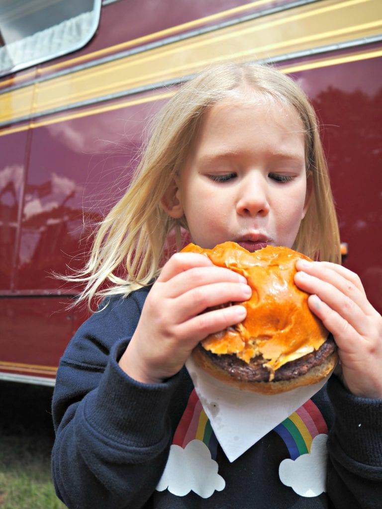 Aria eating a burger at Carter's Fair