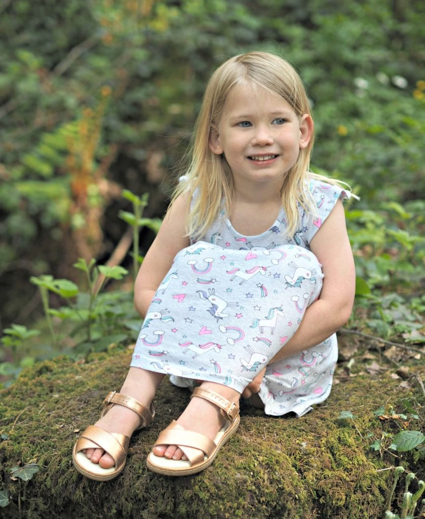 To my Daughter on her 5th Birthday - Aria sitting on a mossy rock