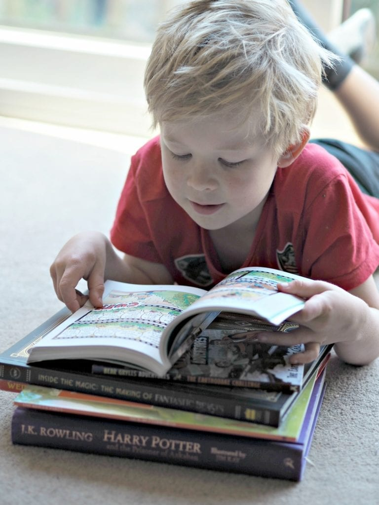 When You Suspect Your Child Might be Gifted - Logan lying down reading books