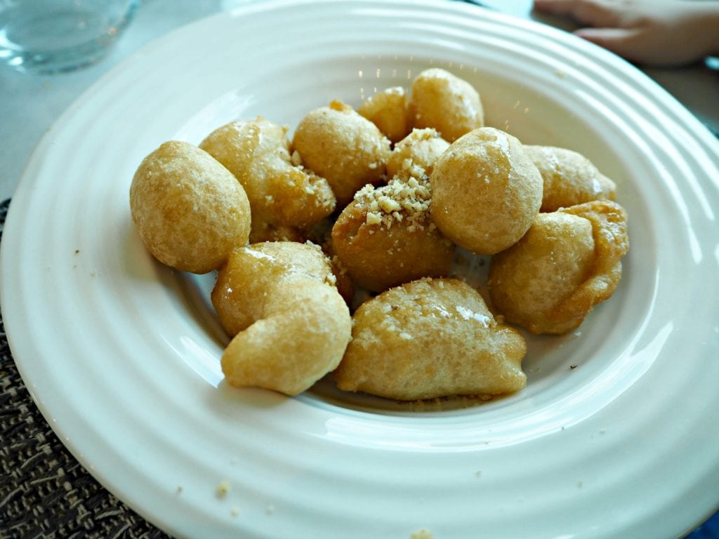loukamades - greek doughnuts served with honey