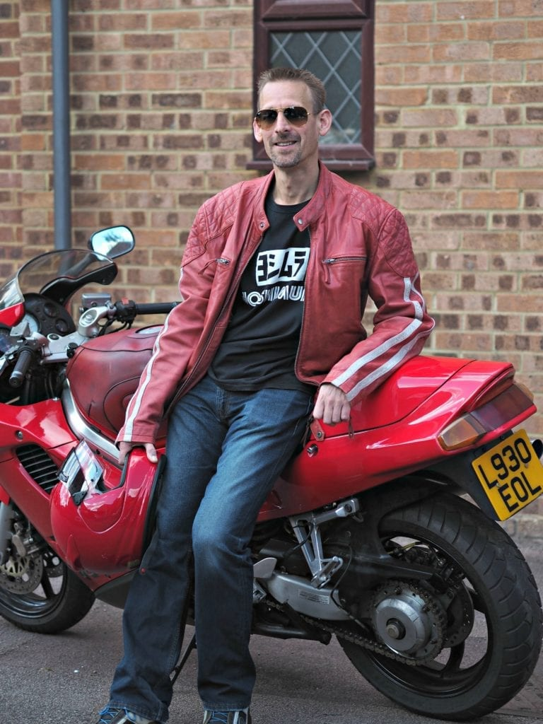 My summer style 2019 - Ben on motorbike wearing red leather jacket with Ray-ban aviators on