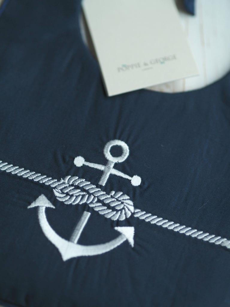 Poppie and George anchor bib close up