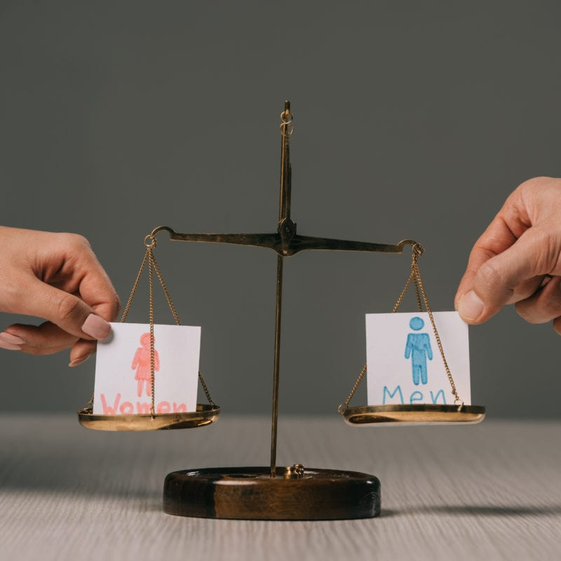 Gender Equality, Bias and Why I Think Positive Discrimination is Vital - scales with men and women symbols on each side