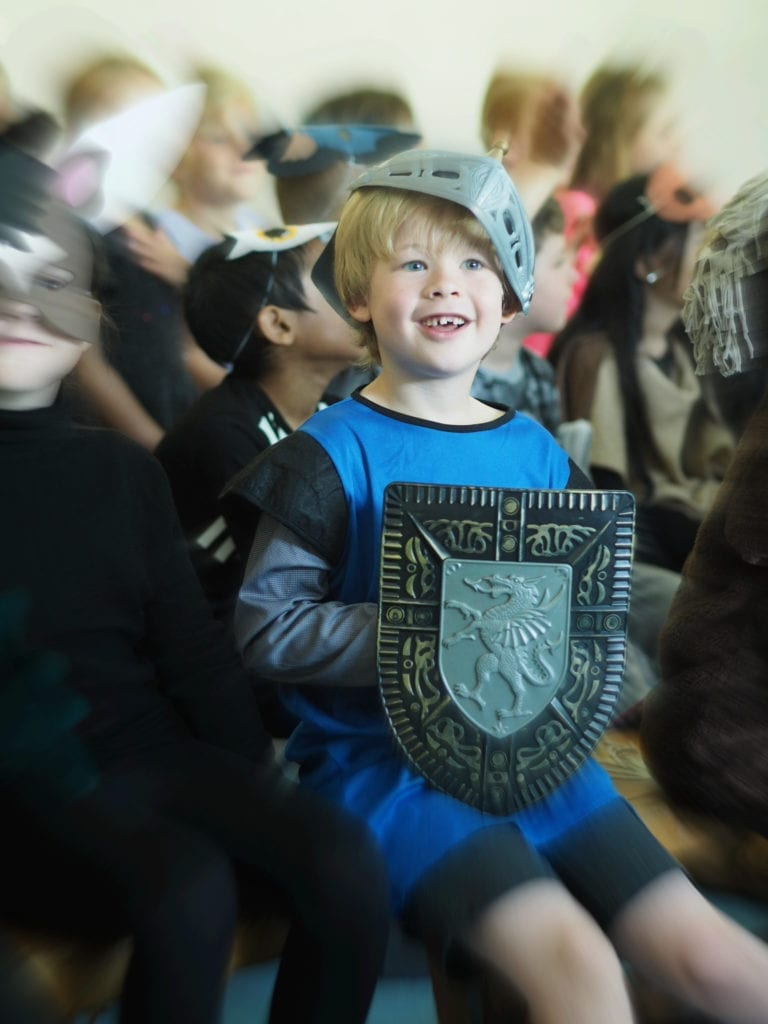 Logan in his school play dressed as a Knight
