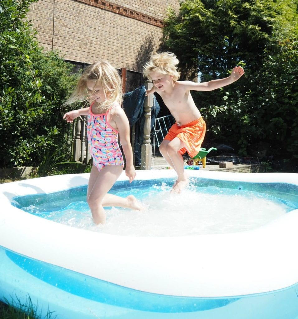 50 Free or Cheap Things to do in the Summer Holidays - Aria and Logan playing in the paddling pool