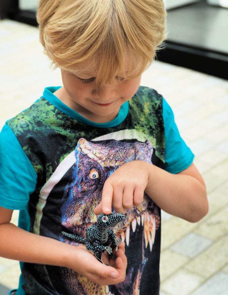 Logan holding mini dinosaur
