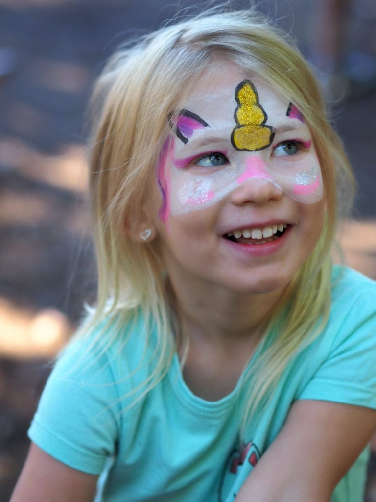 Aria after having her face painted as a unicorn