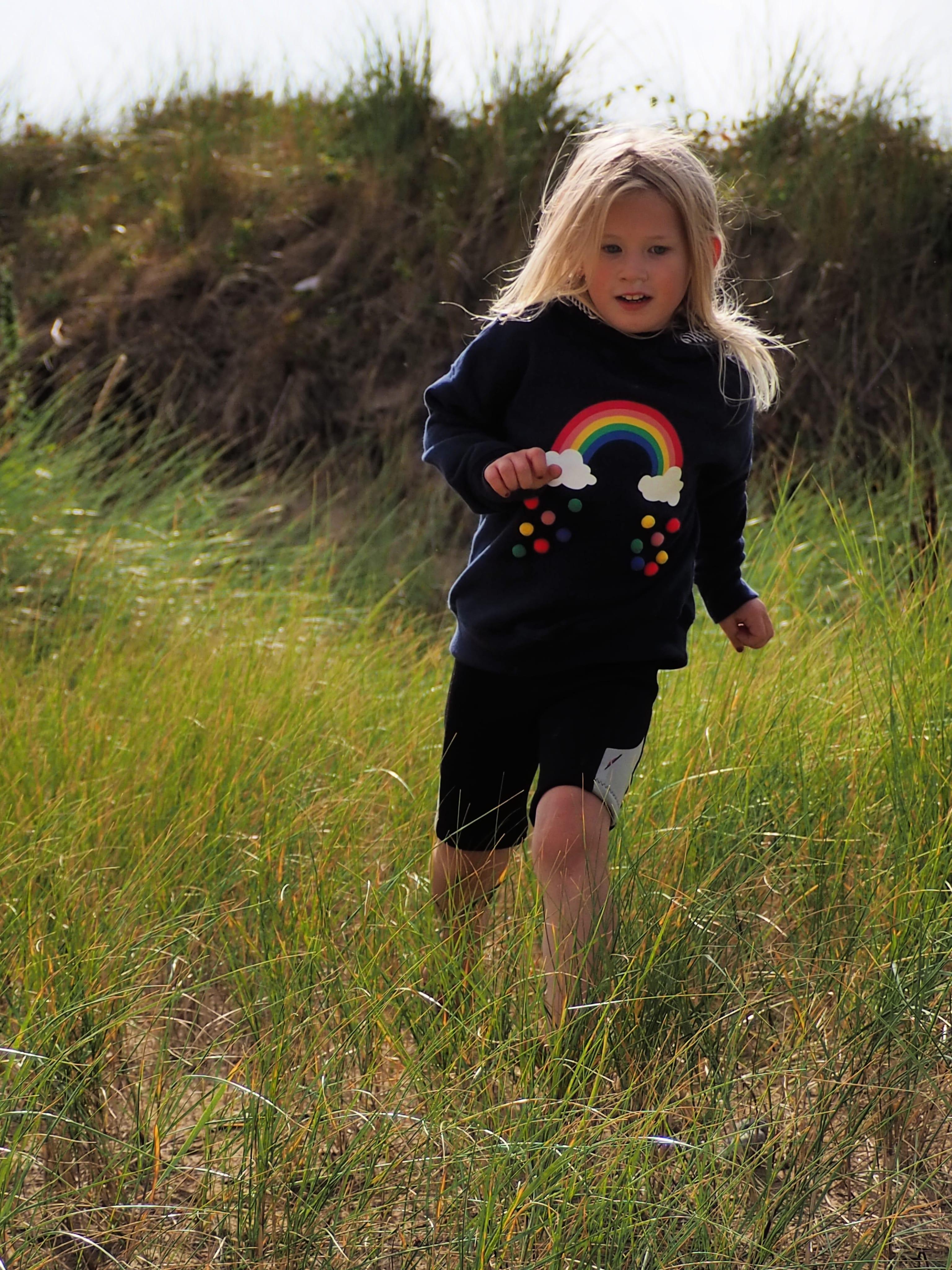 Aria running in the dunes