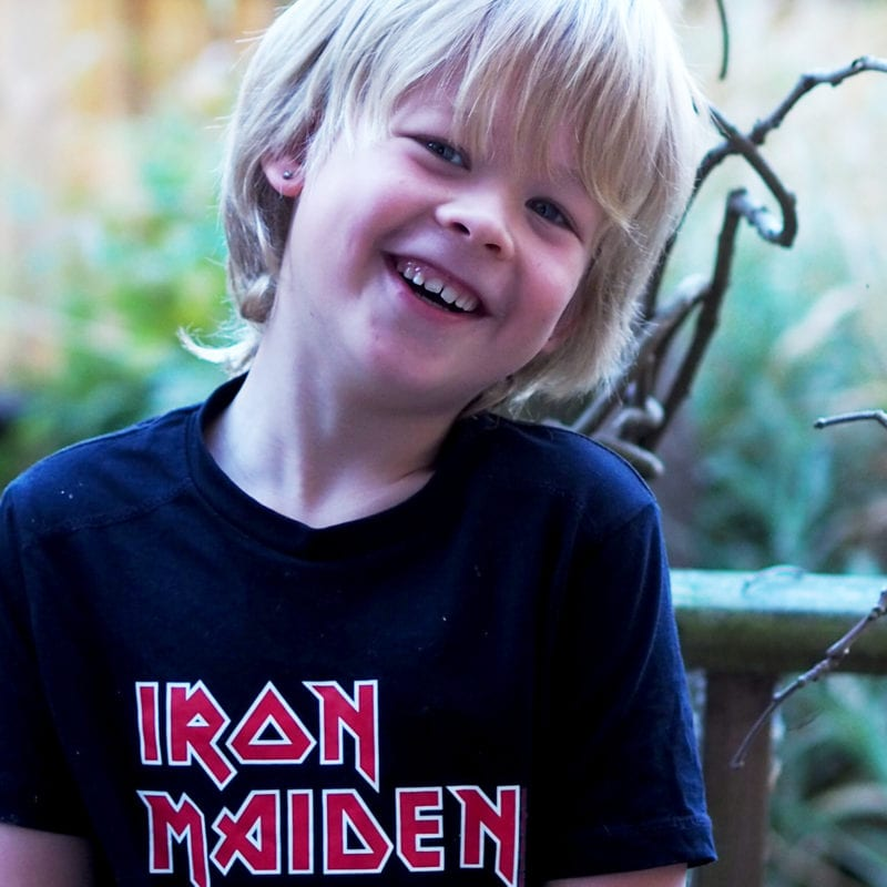 Picture of Logan smiling in a black Iron Maiden t-shirt