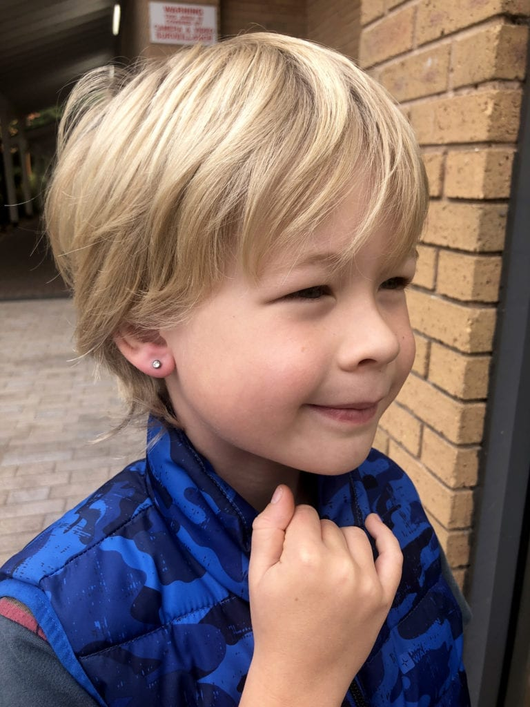 Should boys have their ear pierced? Logan with his new ear piercing