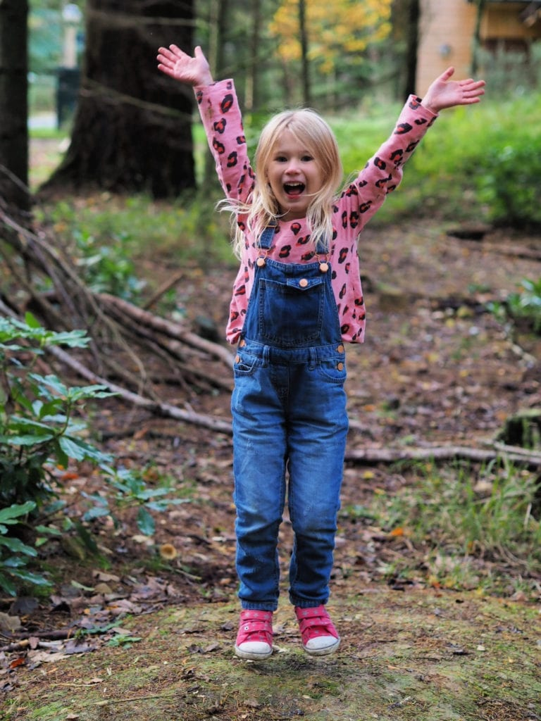 Aria jumping in the forest at center parcs