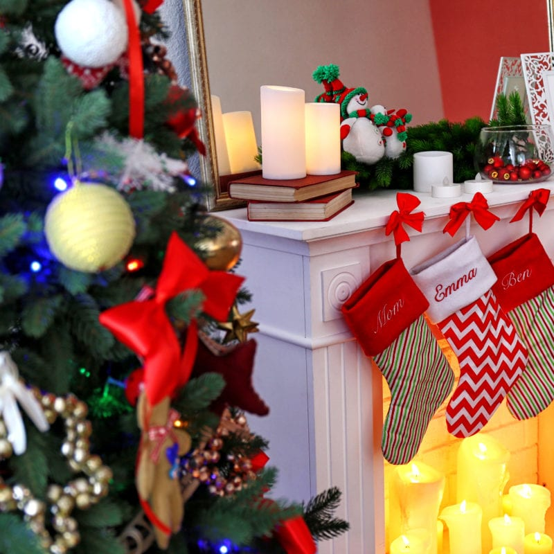 Beautiful fireplace with stockings decorated for Christmas