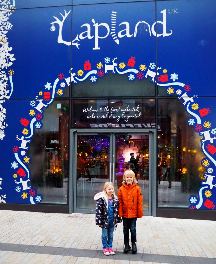 Logan and Aria outside the Lapland UK wishing store
