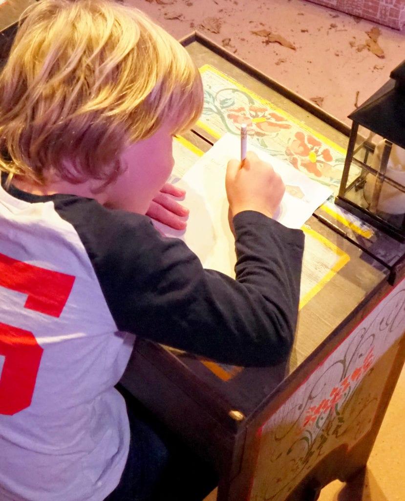 Logan writing his letter