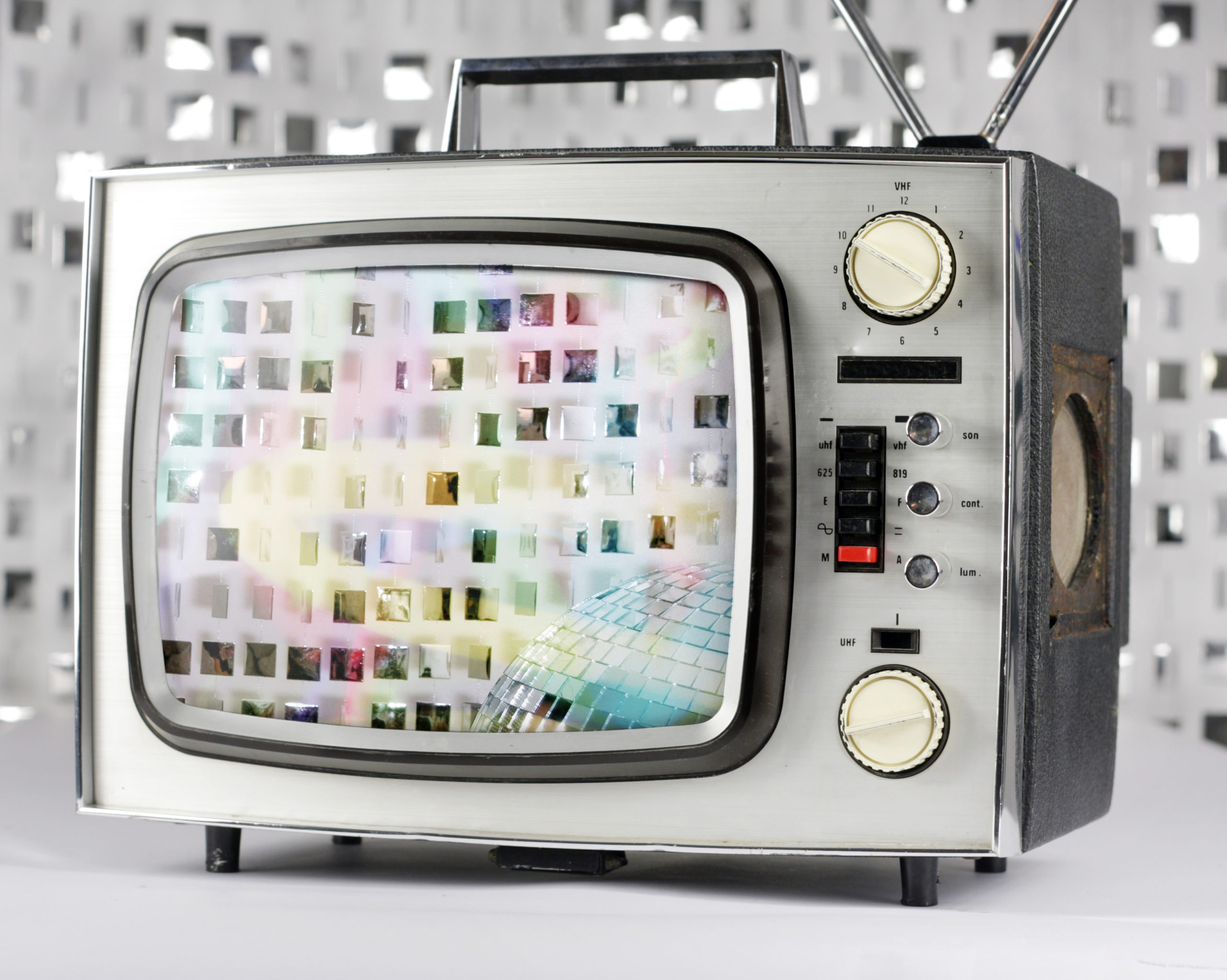 retro tv with sparklling discoball on screen