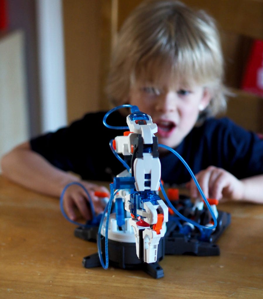 Hydraulic Robot Arm Review Logan playing with arm on table