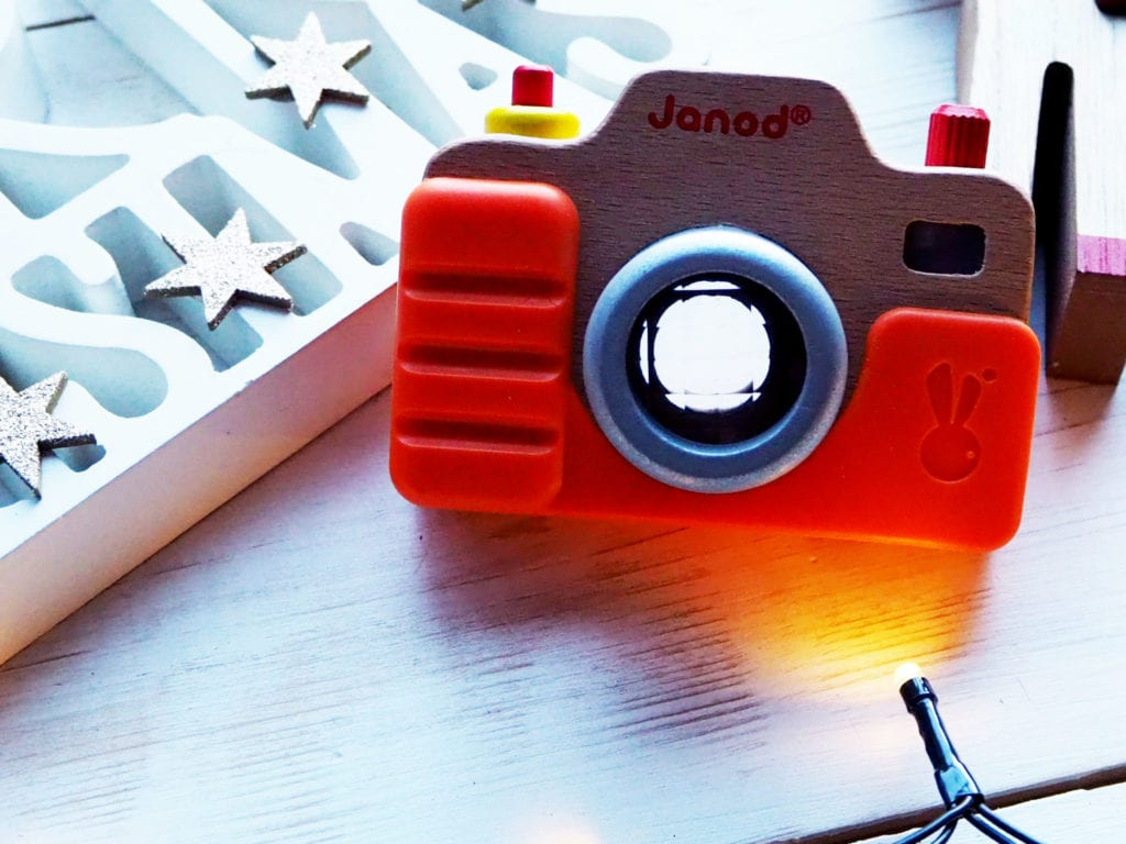 Picture of wooden toy camera with Christmas sign and lights