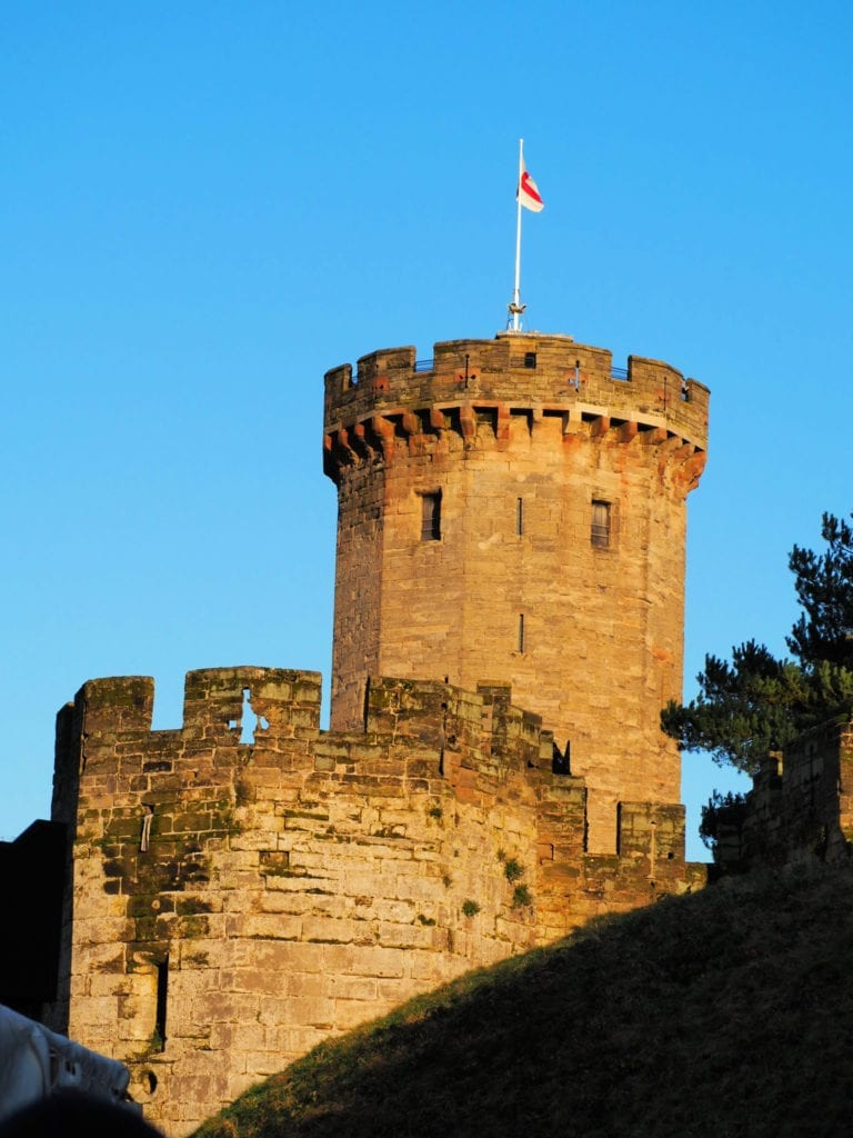 Picture of a turret flying the English flag at Warwick Castle