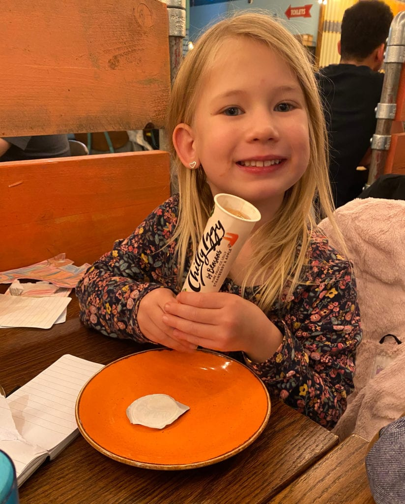 Aria eating an ice lolly at Las Iguanas