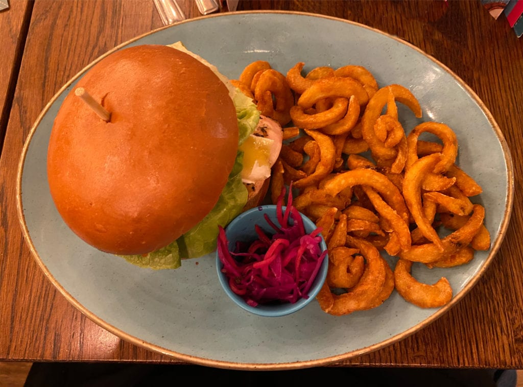 Chicken burger with curly fries